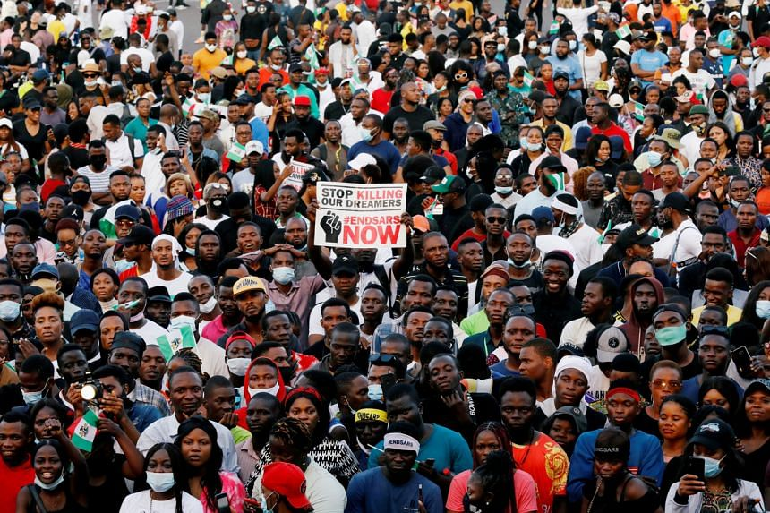 In this picture taken on Oct 17, demonstrators are seen during a protest over alleged police brutality in Lagos, Nigeria.