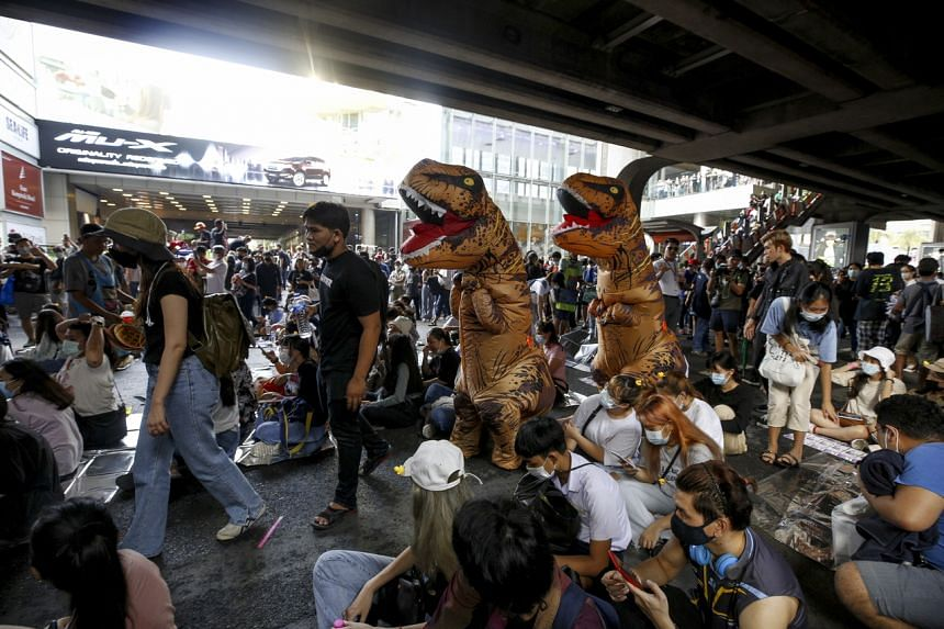 Thai students dressed in dinosaur costumes take part in an anti-government demonstration in Bangkok on Nov 21, 2020.