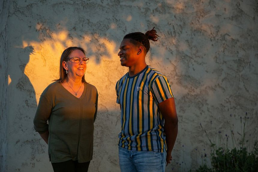 Wanda Dench and Jamal Hinton, who met in 2016, at her home in Arizona on Oct. 29, 2020.
