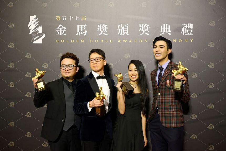 Songwriters (from left) Keon Chia, Tan Boon Wah and Hooi Yuan Teng and actor Edward Chen of Your Name Engraved Herein with the Best Original Film Song award yesterday. PHOTO: REUTERS