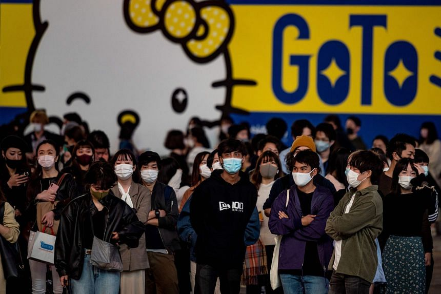Tokyo recorded 539 new Covid-19 infections yesterday, marking the third straight day the city has logged more than 500 cases. PHOTO: AGENCE FRANCE-PRESSE