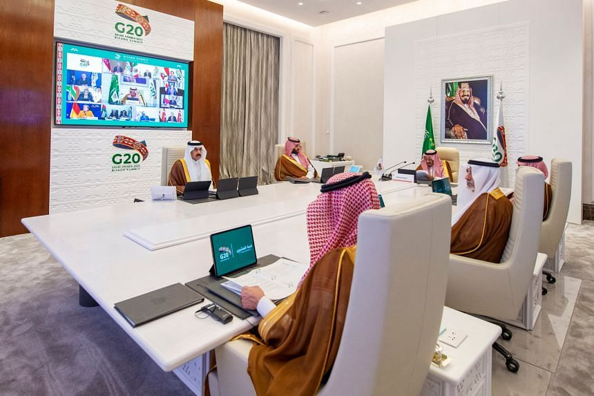 Saudi Arabia's King Salman bin Abdulaziz Al Saud (head of table) giving a speech during an opening session of the virtual Group of 20 summit in Riyadh yesterday. World leaders are huddling virtually in the two-day meeting as international efforts int