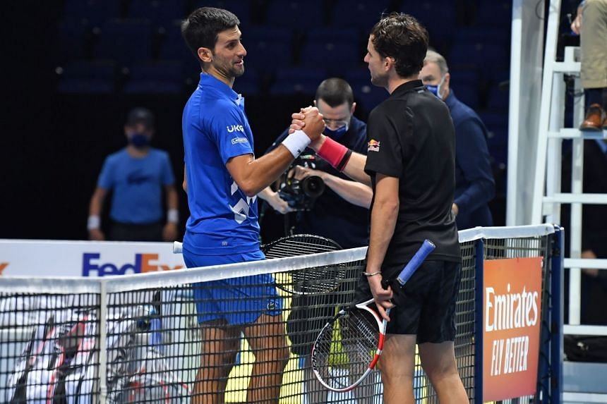 Austria's Dominic Thiem consoles Serbia's Novak Djokovic after his victory in their ATP men's singles semi-final match in London on Nov 21 2020