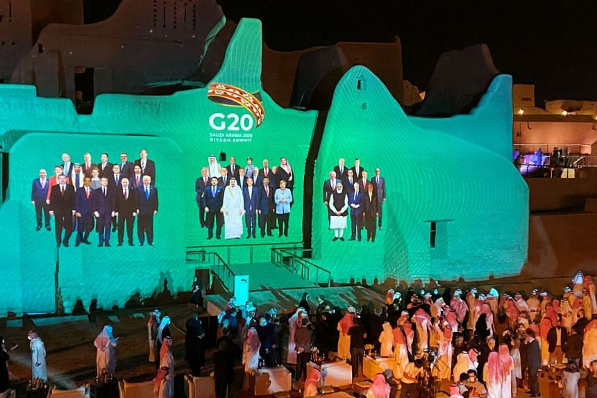 "Projection of a ""Family Photo"" for the annual G-20 Leaders' Summit onto Salwa Palace in At-Turaif, Saudi Arabia, on Nov 20, 2020."