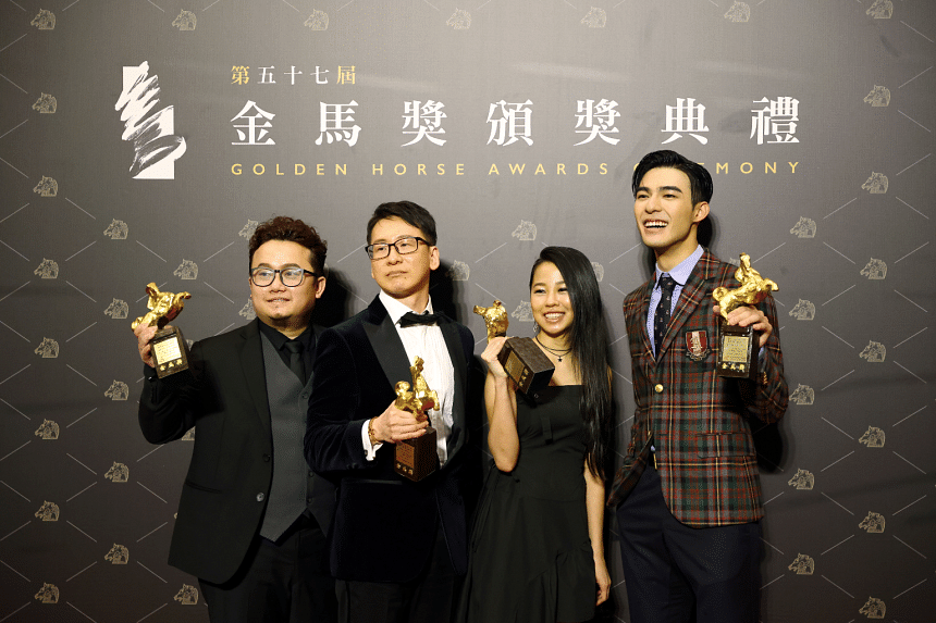 """(From left) Keon Chia, Tan Boon Wah, Hooi Yuan Teng and Edward Chen pose with the Best Original Film Song award for """"Your Name Engraved Herein"""" at the 57th Golden Horse Awards in Taipei, on Nov 21, 2020."""