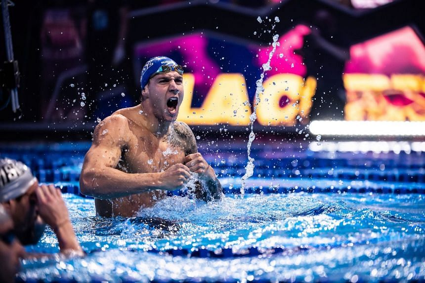 Dressel celebrates after breaking the 100m individual medley world record on Nov 16, 2020.