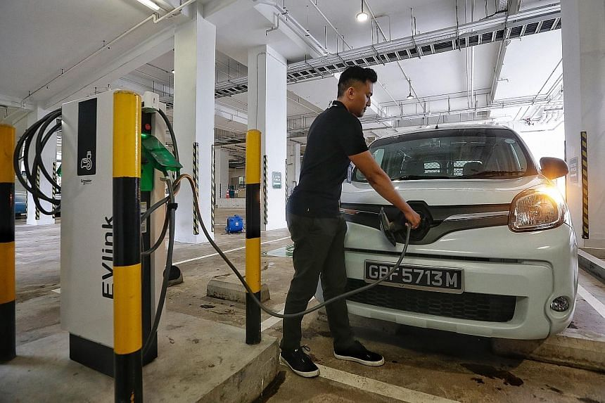 Singapore is growing its network of electric vehicle charging points. The writer says the use of mobile chargers that operate like power banks for smartphones can help prevent long queues at charging stations. ST PHOTO: KEVIN LIM