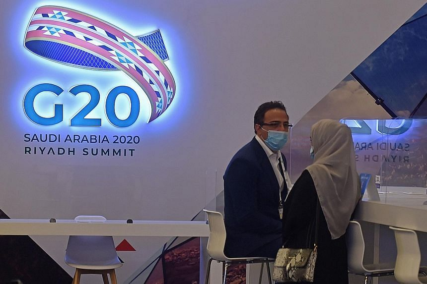 Journalists in an almost empty media room last Friday in Riyadh set up for the coverage of the G-20 summit, which is being held virtually due to the coronavirus pandemic. A physical summit would have been an opportunity to showcase Saudi Arabia's amb