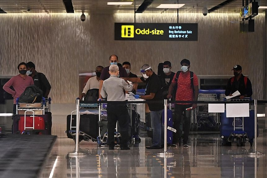 Passengers arriving at Changi Airport Terminal 1 earlier this month. The air travel bubble with Hong Kong was slated to launch with one flight into each city and each flight with a maximum capacity of 200 passengers. On Saturday evening, it was annou