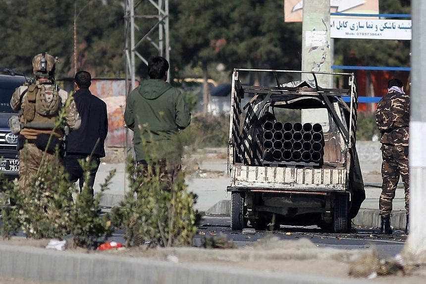 An unfired rocket in a damaged vehicle in the aftermath of an attack in Kabul last week. Afghanistan's economy is set to contract by at least 5.5 per cent this year due to Covid-19, the World Bank said in a recent report.