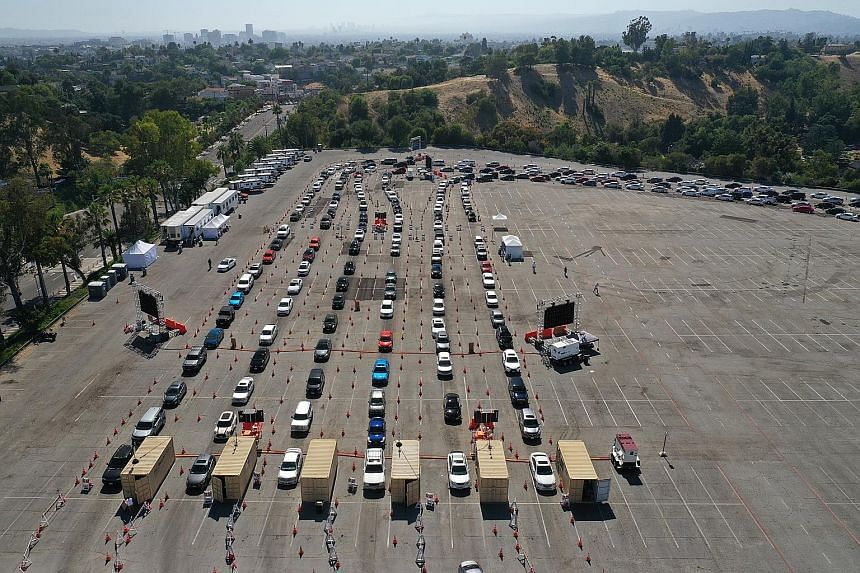 Cars lined up at a Covid-19 drive-through testing site in Los Angeles, California, in July. The United States has recorded over a quarter of a million deaths from the disease amid the pandemic.