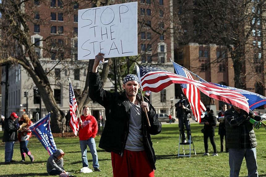 Trump supporters protesting against the 2020 US presidential election results in Lansing, Michigan, last Saturday. Mr Donald Trump is seeking to invalidate or change the vote's results through recounts and pressure on lawmakers. He would need to prev