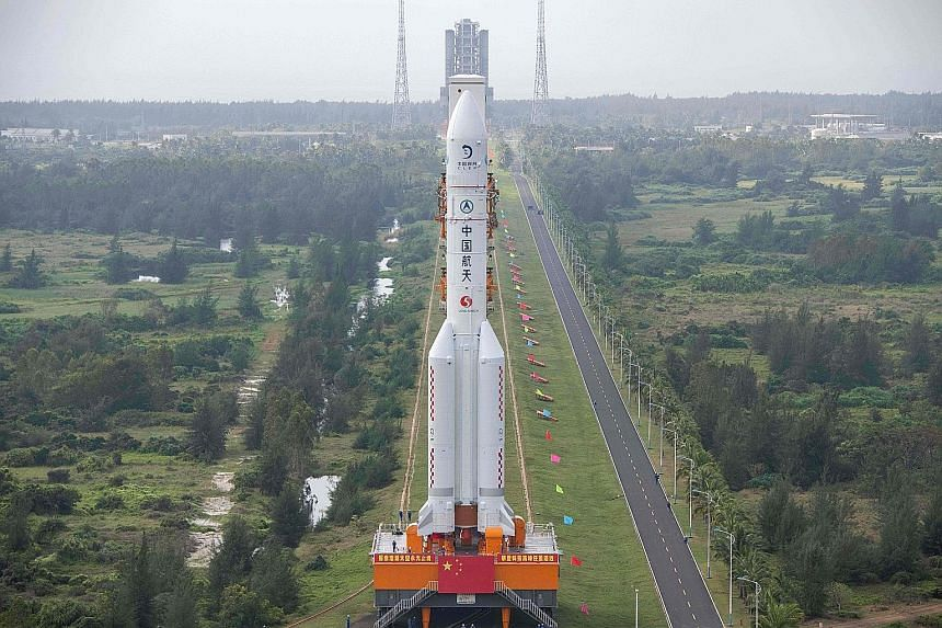 A Nov 17 photo of the Long March 5 rocket being transported to the launching area at the Wenchang Spacecraft Launch Site in southern China's Hainan province. The rocket will launch China's Chang'e-5 lunar probe this week.