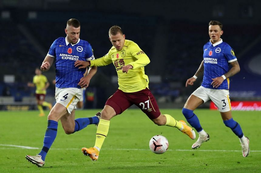 Burnley's Czech striker Matej Vydra (centre) runs at goal during the EPL football match against Brighton and Hove Albion on Nov 6, 2020.
