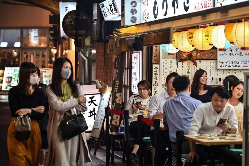 People gather at an izakaya restaurant during a rainy evening in Tokyo on Oct 7, 2020.