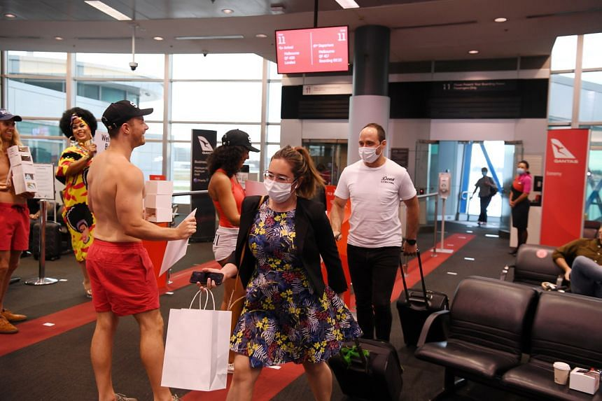 Passengers disembark from the first Qantas flight from Melbourne, Victoria, following the lifting of state border restrictions.