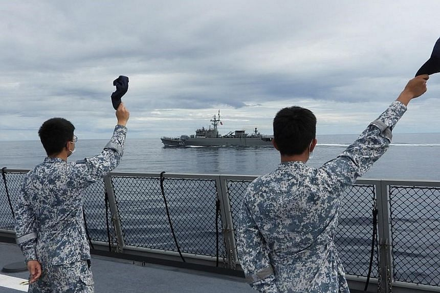 Republic of Singapore Navy sailors on the deck of the RSS Intrepid waving during the sail-past to conclude the maritime exercise. Due to the Covid-19 pandemic, the crew of the RSS Intrepid and RSS Endeavour were isolated and tested negative for the v