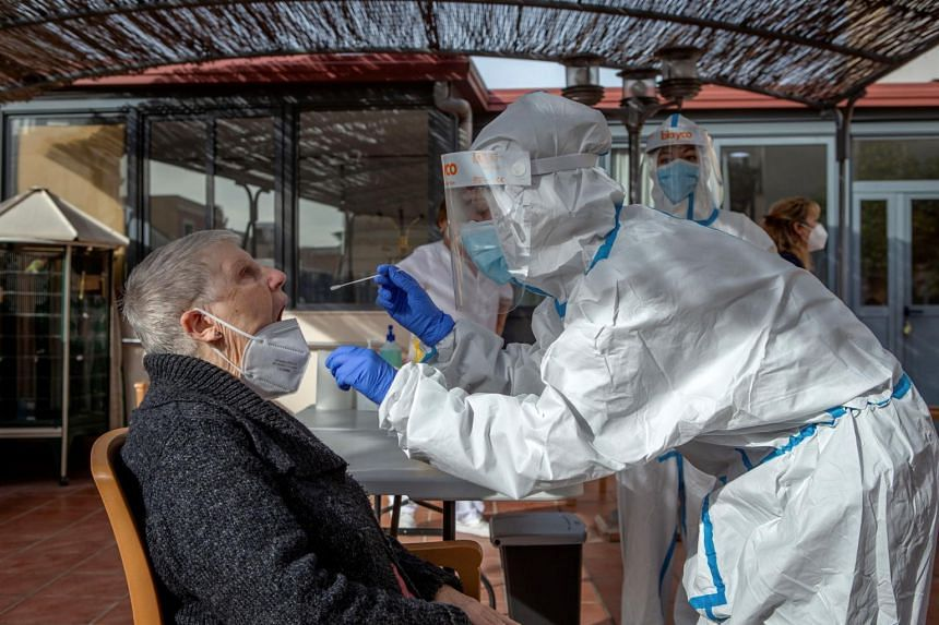 A healthcare working taking a swab sample from a resident of the Campoamor nursing home in Barcelona on Nov 13, 2020.