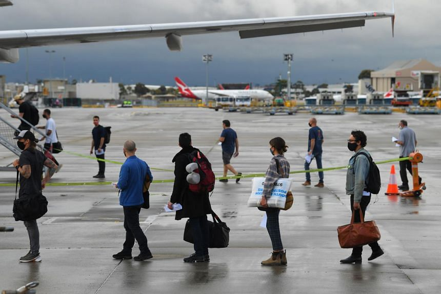 Passengers are seen boarding a Jetstar flight to Sydney at Melbourne Airport on Nov 23, 2020.