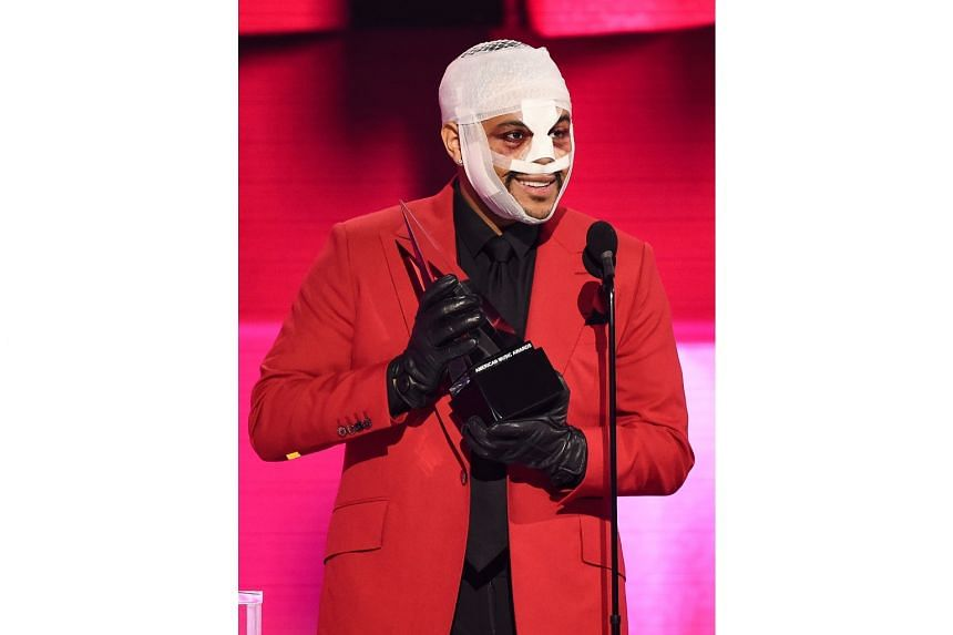 The Weeknd Shocks Fans With Bloodied, Bandaged Head At AMAs