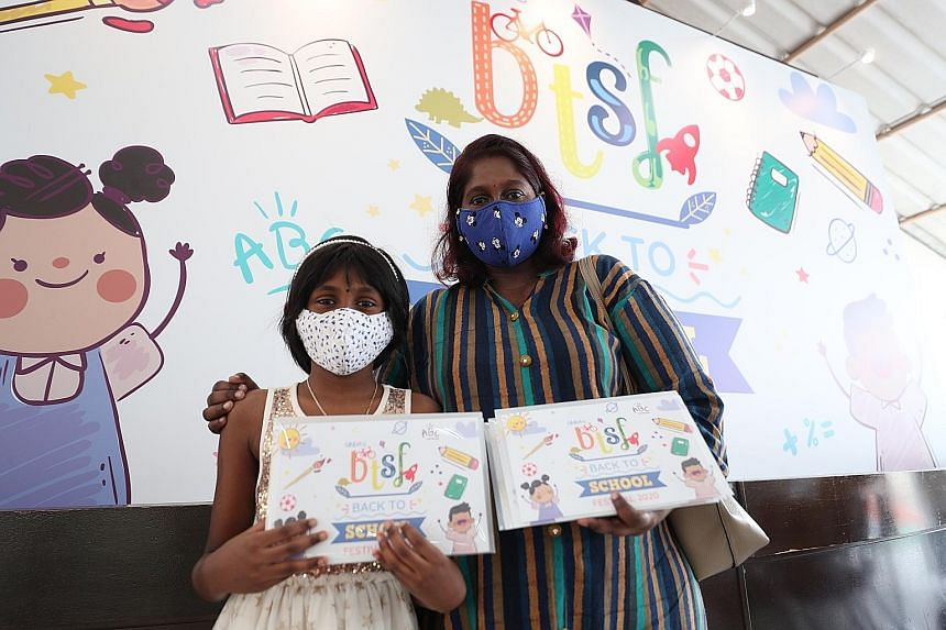 Ms Senthamarai V. Subramaniam, 38, and her daughter Sashrikaa Selvam, nine, with the kit. After she lost her sales job in March, Ms Senthamarai, who is the sole earner of the family, set up a home-based business selling masks and cookies with her hus