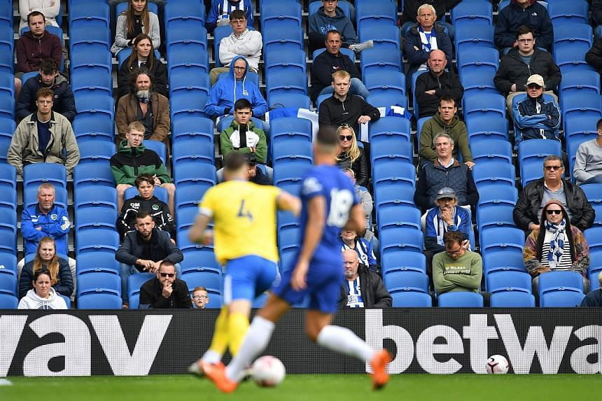 Socially distanced fans watching a friendly between Brighton and Chelsea at the Amex Stadium in August.