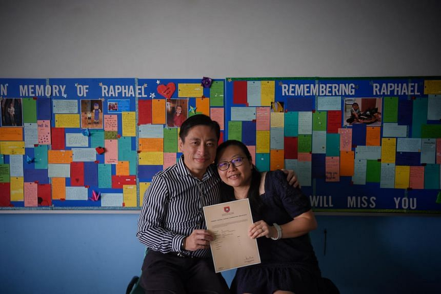 Mr William Lee and his wife Winnie with their son Raphael's PSLE results. Raphael did not want to defer taking his PSLE despite undergoing treatment for cancer.