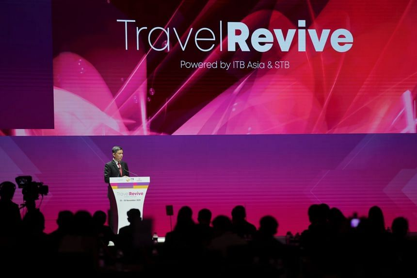 Trade and Industry Minister Chan Chun Sing speaking at TravelRevive at the Sands Expo and Convention Centre on Nov 25.