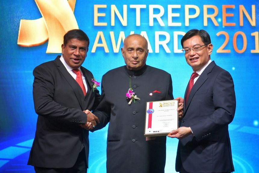 Mr Ameerali R. Jumabhoy (centre) receiving the SICCI Lifetime Achievement Award from Deputy Prime Minister Heng Swee Keat in the presence of SICCI chairman T. Chandroo last year.
