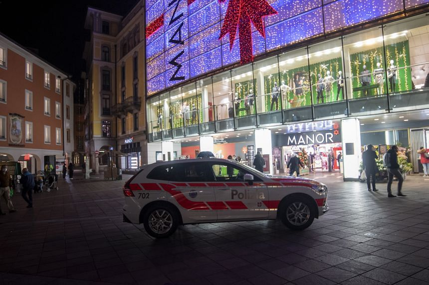 Police in front of the Manor department store in Piazza Dante in Lugano, Switzerland, on Nov 24, 2020.