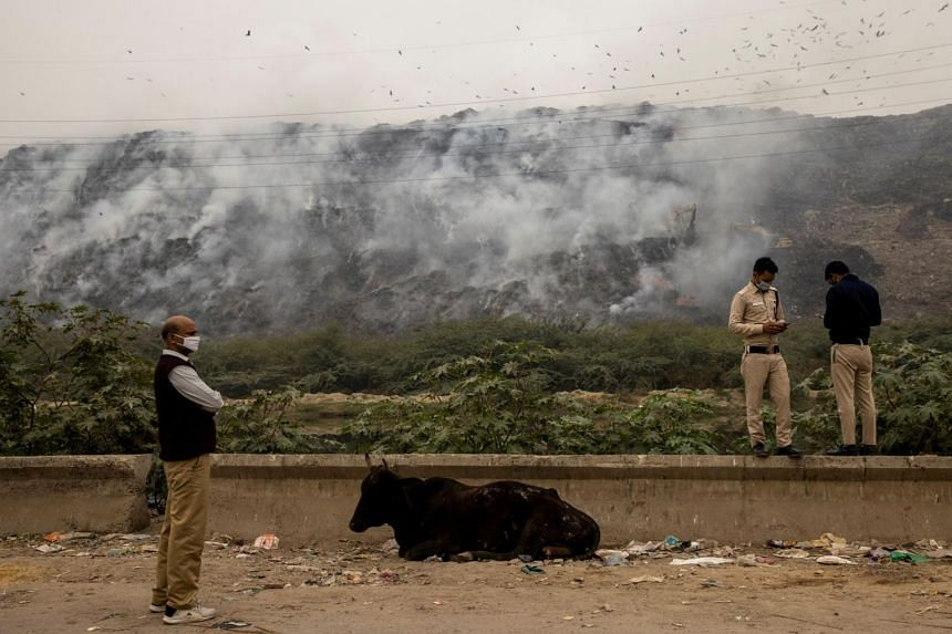 A mountainous waste landfill site caught fire, releasing poisonous smoke into the atmosphere, in New Delhi, on Nov 25, 2020.