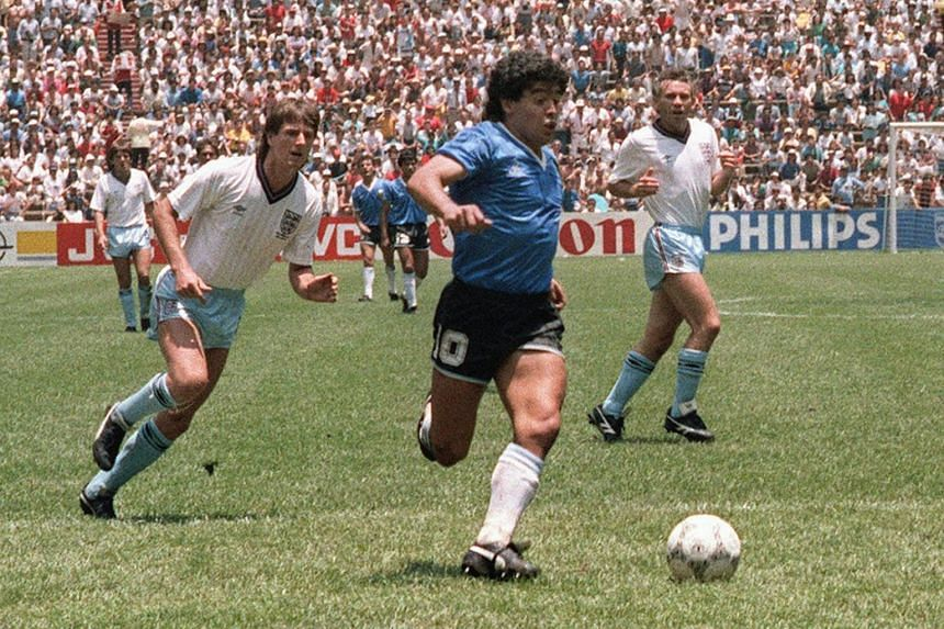 In a photo from June 22, 1986, Diego Maradona (centre) runs past English defenders on his way to scoring his second goal during the World Cup quarterfinal match between Argentina and England.