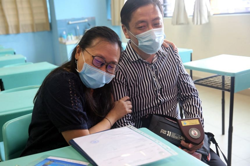 Mr William Lee and his wife Winnie collected his results on behalf of their son Raphael on Nov 25, 2020.
