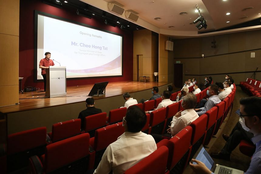 Senior Minister of State for Transport and Foreign Affairs Chee Hong Tat speaking at the launch of the digital plan for chartered bus services at the Land Transport Authority office yesterday. He said it is now a ''matter of survival'' that operators