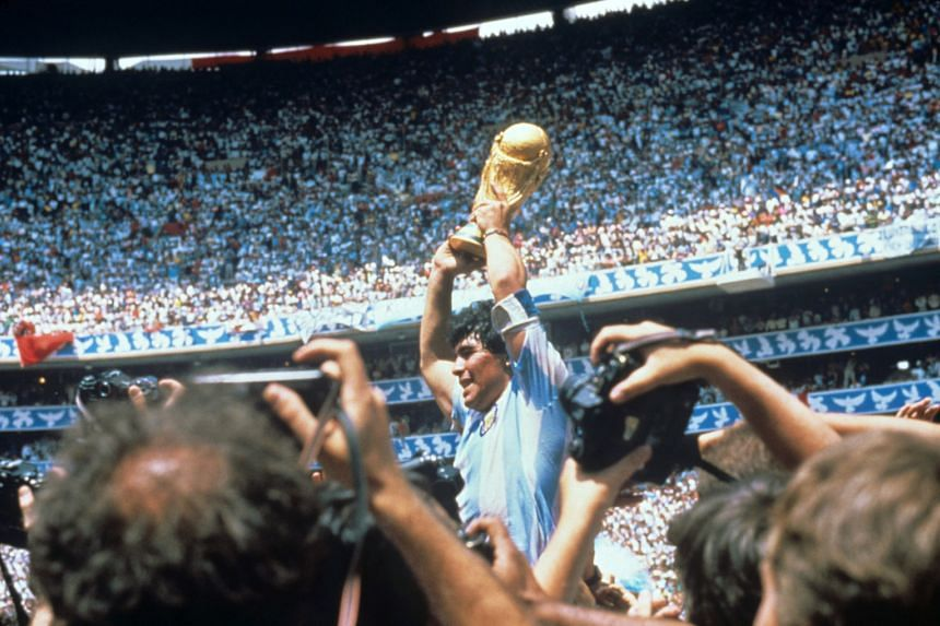 Diego Maradona lifts the Fifa World Cup trophy after defeating Germany at the Azteca stadium in Mexico City, on June 29, 1986.