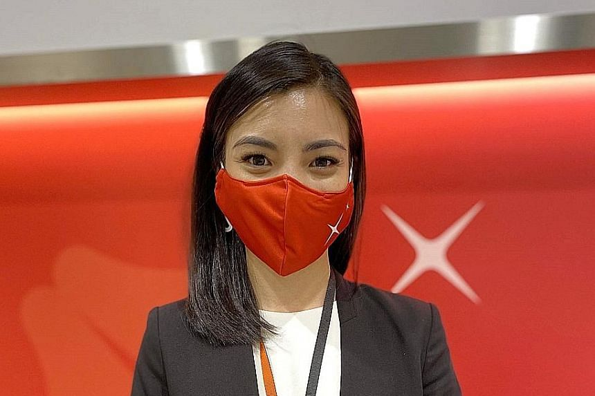 Former flight stewardess Brinda Cheng, a wealth planning manager at DBS' Bishan branch, is among over 2,000 people the bank hired this year.