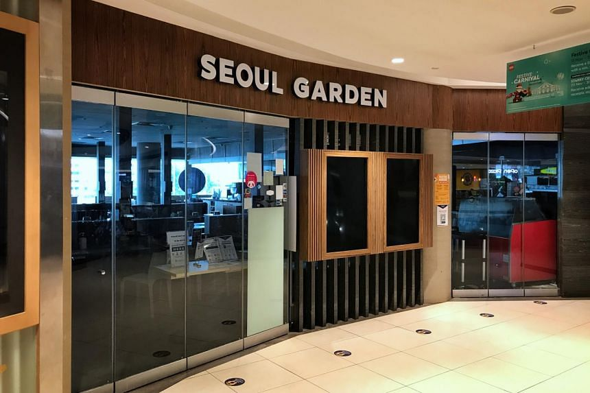 Some customers arrived just before lunch at Seoul Garden, but walked off after seeing the notice that it was closed.