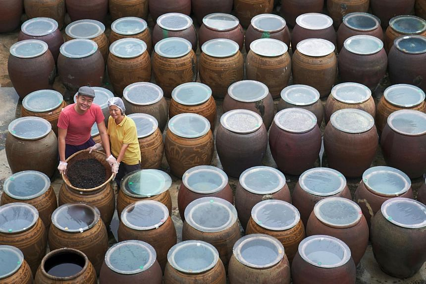 Ken Koh, 36, tends to as many as 100 vats of soya sauce daily with his mother, Mdm Tan Poh Choo, 63.