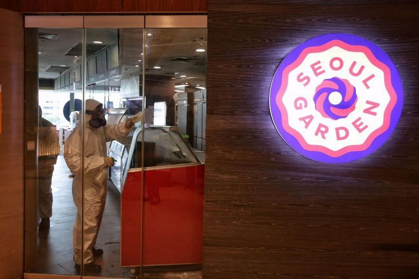 A cleaning company employee disinfects the interior of Seoul Garden in Tampines Mall on Nov 27, 2020.