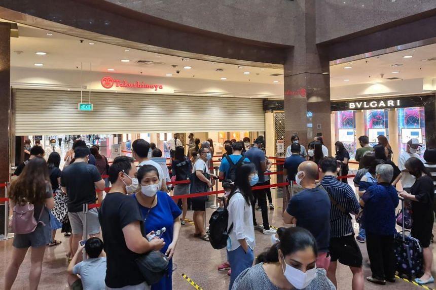 Shoppers queue to enter Takashimaya for the Black Friday sale on Nov 27, 2020.