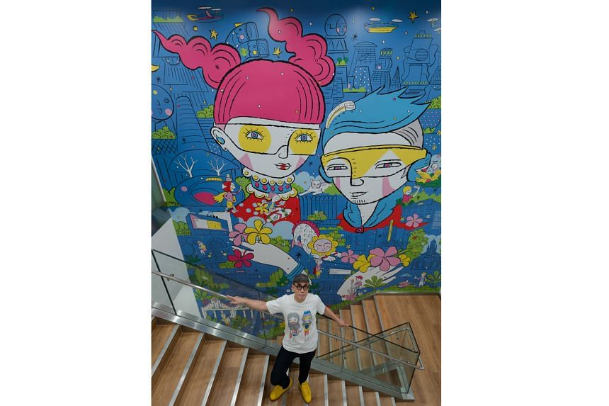 The newly renovated store at Ion Orchard reopens today, with an in-store mural about Orchard Road by local visual artist Michael Ng (above), who goes by Mindflyer.