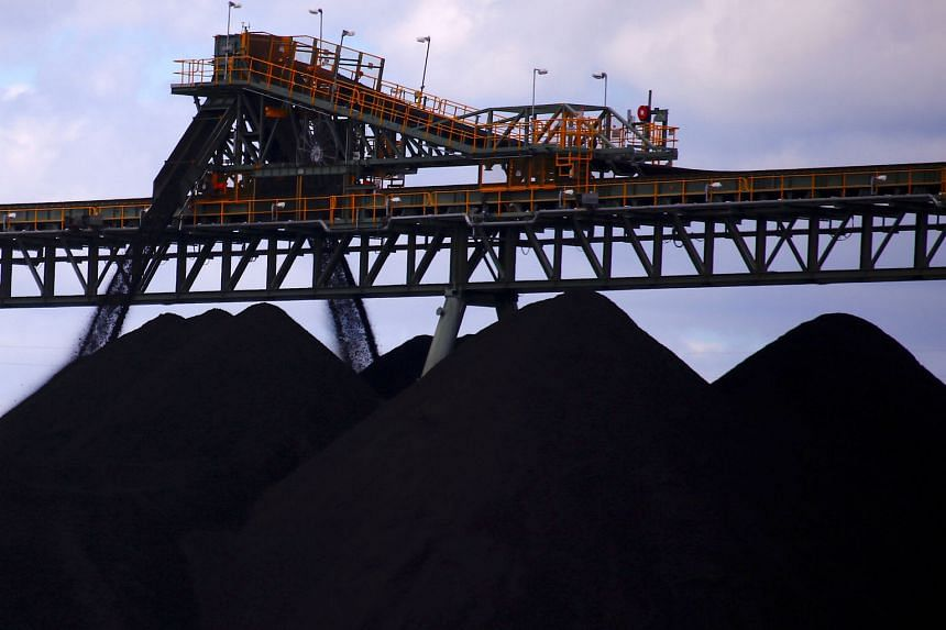 Coal being unloaded at the Ulan Coal mines near the New South Wales rural town of Mudgee in this file picture taken in March 2018. About 1,000 crew members on coal-laden Aussie ships are stuck amid China's blacklisting.