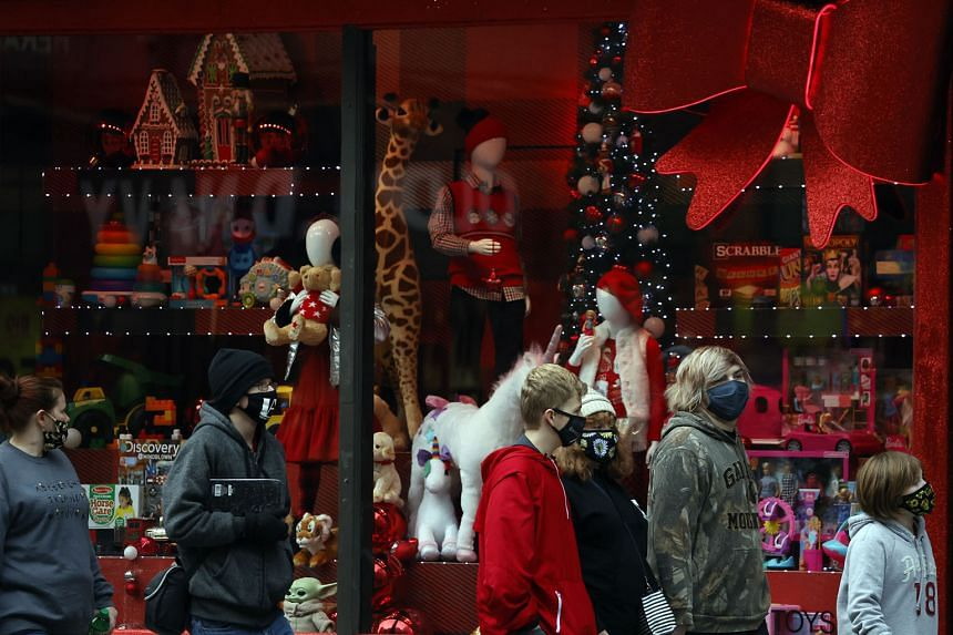 Macy's Christmas windows in New York City. US President-elect Joe Biden is said to be considering former Fed vice-chair Roger Ferguson and BlackRock executive Brian Deese to be his top White House economic adviser, according to people familiar with t
