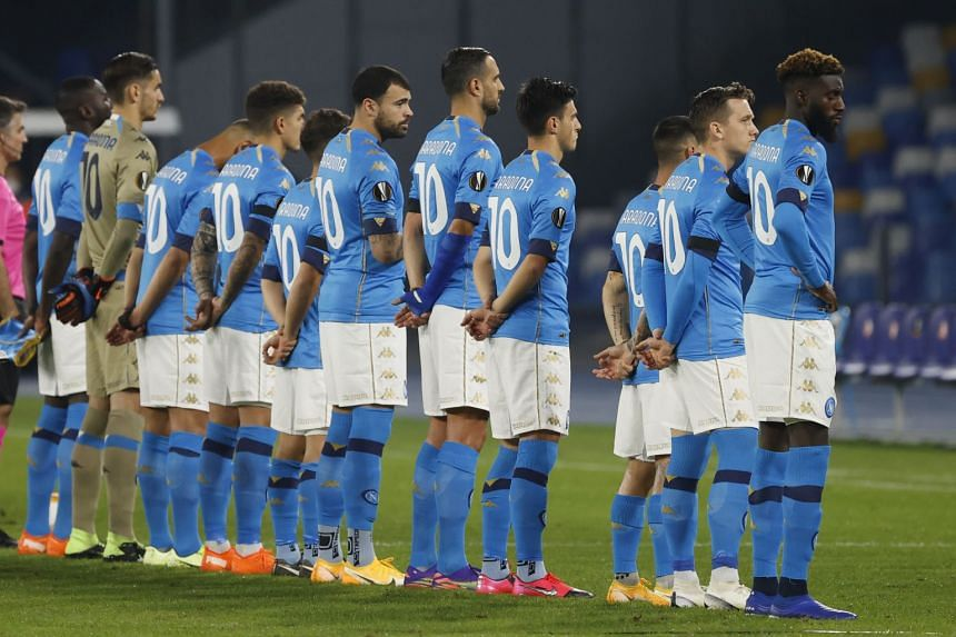 Napoli players line up wearing shirts with Diego Maradona's name on the back before the match.