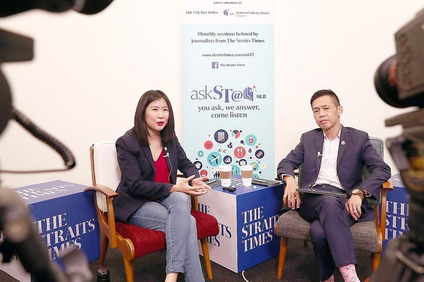 """Straits Times travel correspondent Clara Lock and Singapore Tourism Board chief executive Keith Tan at askST@NLB's second November session. Mr Tan hopes that Singaporeans will """"take the time to slow down, step out and be proud of this beautiful littl"""