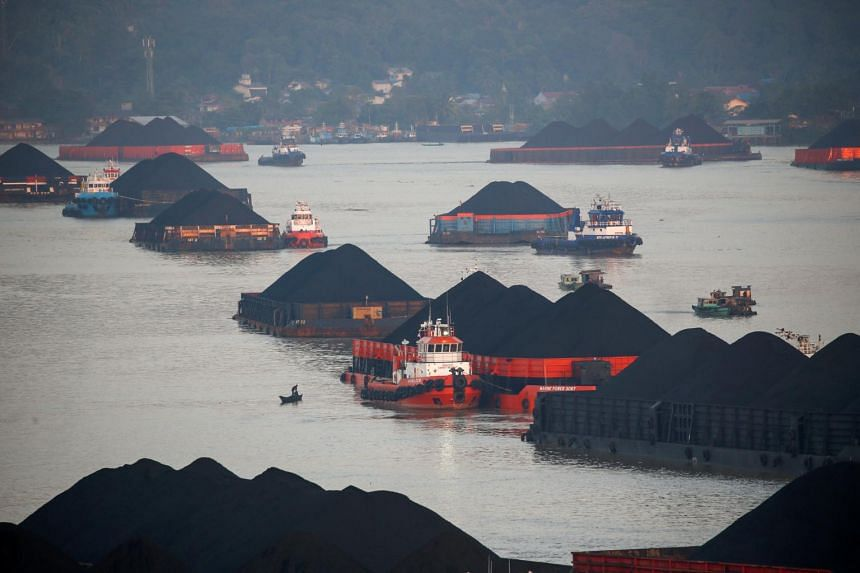 Coal barges queue to be pulled along Mahakam river in Samarinda, East Kalimantan, Indonesia, on Aug 31, 2019.