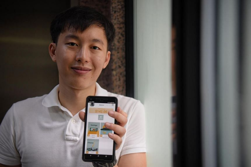 Taby Technologies co-founder Yap Jun Yi showing off the companies' personal finance app.