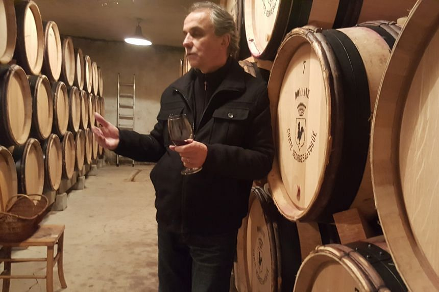 Mr Francois Millet, winemaker at Comte Georges de Vogue, in the cellar of the Domaine.