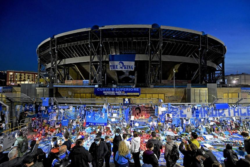 """Fans tied hundreds of blue-and-white scarves to the railings outside, chanting, """"Diego, Diego"""" and other anthems."""