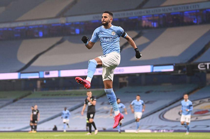 Manchester City's Riyad Mahrez celebrates scoring their first goal against Burnley, on Nov 28, 2020.